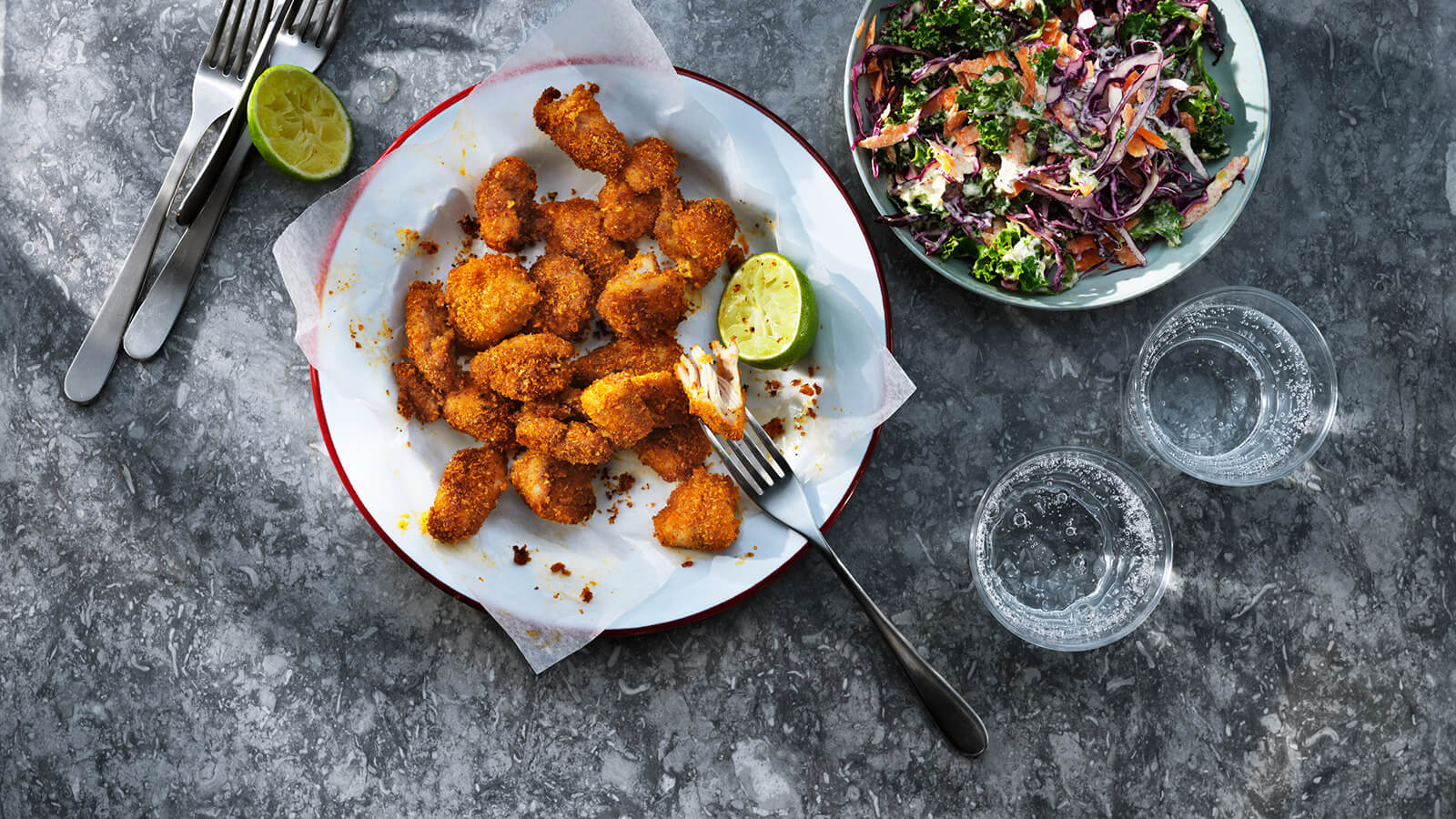 Crispy chicken nuggets and a bowl of coleslaw