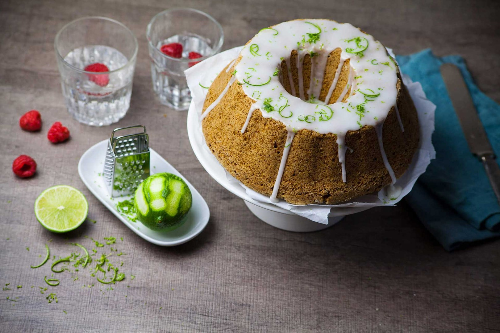 Vegan sponge cake with lime glaze served on a plate