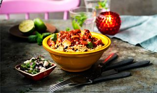 Spicy chilli chicken in a bowl with bean rice