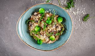 Dish with pearl barley risotto with mushrooms and brussels sprouts