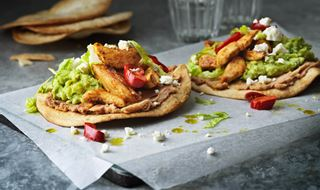 Two tostades with chicken and guacamole